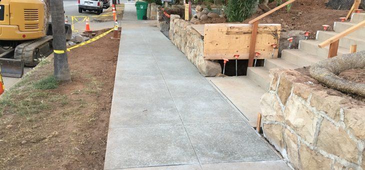 Sidewalk and bio-filtration basin